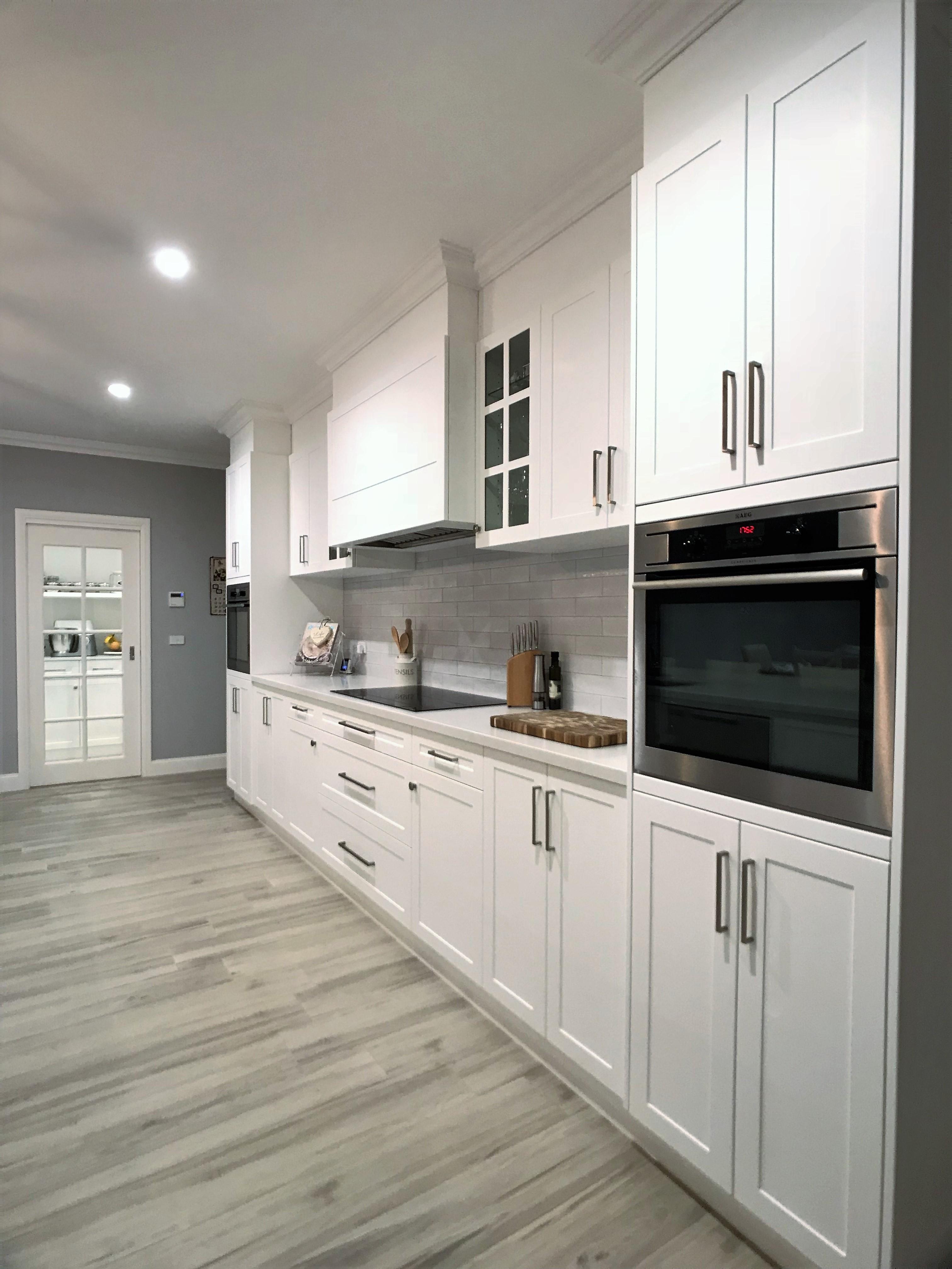 Stylish kitchen with white benchtops and stylish oven.