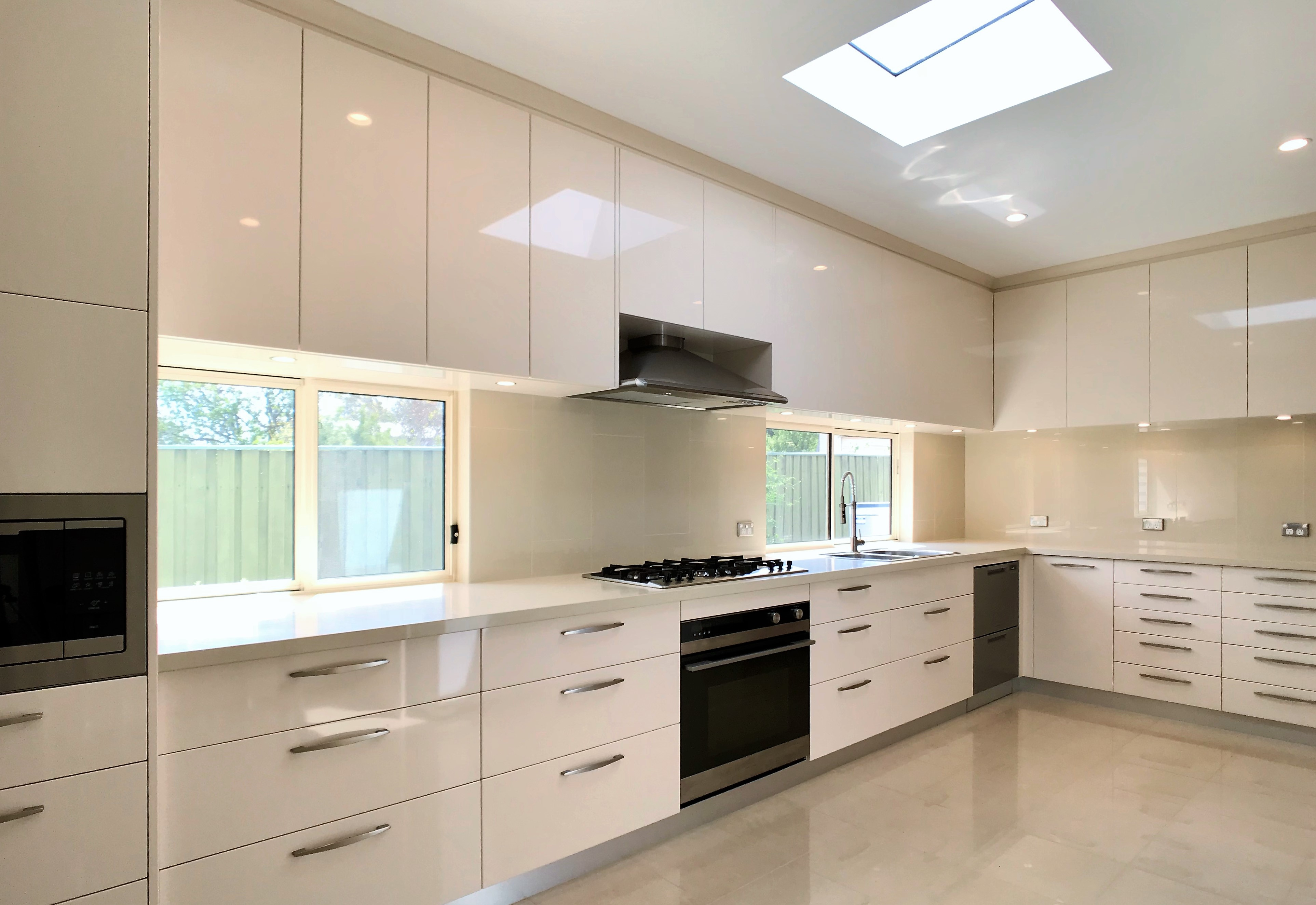 White color themed spacious kitchen deigned and renovated by Paramount Creations.