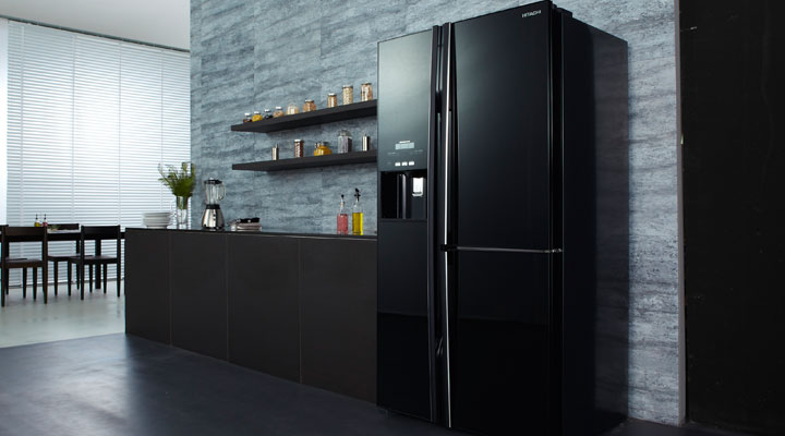 Stylish kitchen with black fridge, brown countertop.
