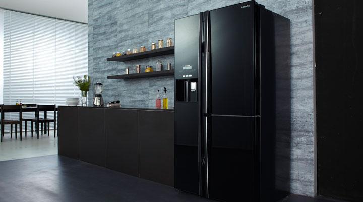 Stylish kitchen with black fridge, brown countertop.