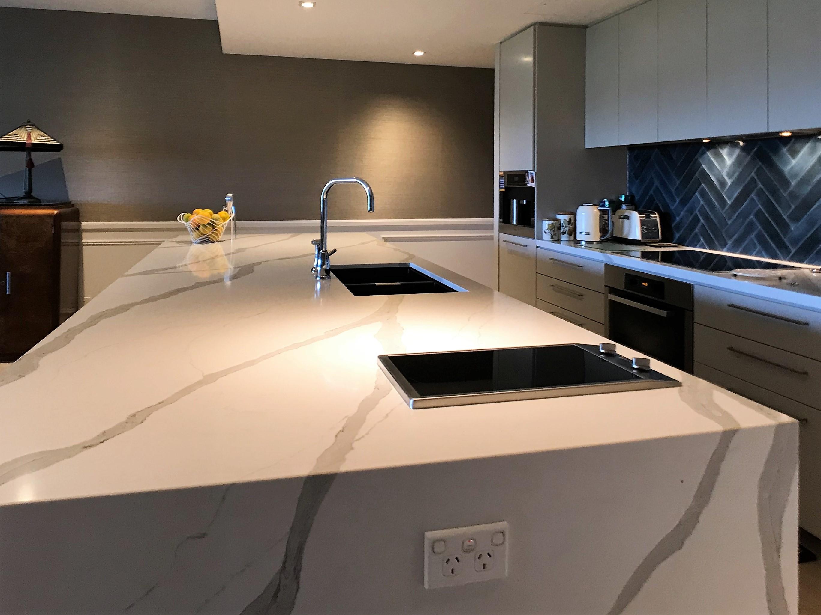 Stylish sinks on kitchen benchtop.